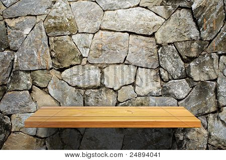 Wood Shelf On Stone Wall