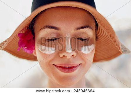 Woman Smile Applying Sun Cream  On Face. Skincare. Body Sun Protection. Sunscreen. Bikini  Woman Sme