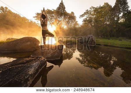Young Asian Woman Practicing Yoga Pose In The Park Yoga And Meditation Have Good Benefits For Health