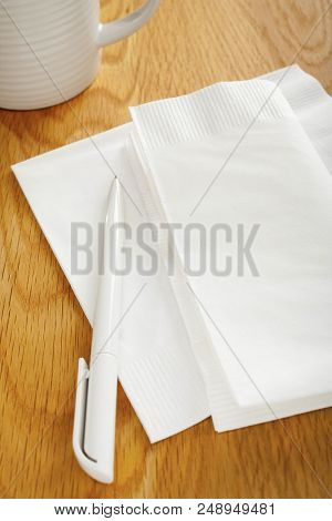 Napkin Or Serviette And Pen On Table - White Napkin Or Serviette And Pen On Oak Surface, Ideal For N
