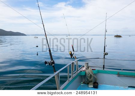 Fishing Rods With Reels On Charter Boat On Tranquil Day At Sea In Far North District, Northland, New
