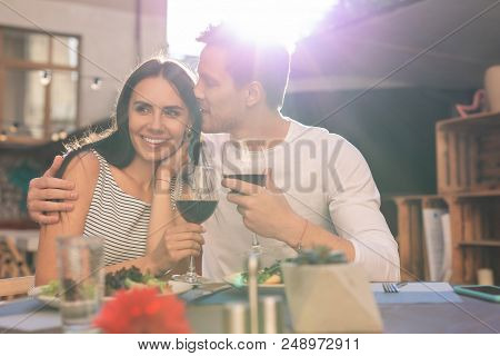 Kissing Wife. Caring Loving Husband Feeling Extremely Happy While Kissing His Wife Celebrating Her B