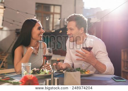 Beaming Businessman. Beaming Successful Businessman Telling His Girlfriend About Day At Work While H