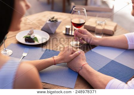 Open Air Terrace. Young Married Couple Feeling Relaxed While Spending Evening On Open Air Terrace