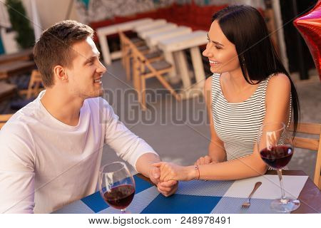 Taking Care. Smiling Blonde-haired Businessman Feeling Contended While Taking Care Of His Woman