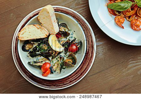 Mussels With Tomatoes. Selective Focus Of Nice Delicious Mussels With Little Cherry Tomatoes And Sav