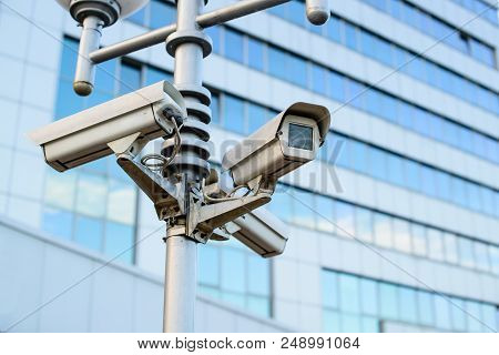 Public City Video Surveillance Cameras On The Lamppost Over Sky, Close-up