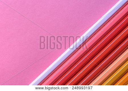 Color Pencils On Pink Pastel Background, Close Up. Set Of Colorful Pencils, Copy Space. Crayons. Top