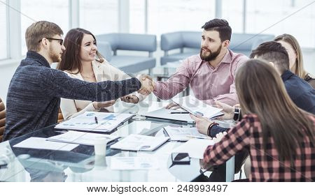 Handshake Financial Partners After The Discussion Of A New Contract In The Workplace In The Office
