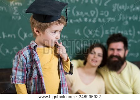 Student In Graduation Cap. Little Student Lost In Thoughts. Student Boy Dedicated To Education. Ther