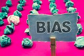 Handwriting text writing Bias. Concept meaning Unfair Subjective One-sidedness Preconception Inequality Bigotry Clothespin holding green paper crumpled papers ideas mistakes several tries poster