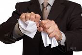 Angry businessman tearing up a document, contract or agreement poster