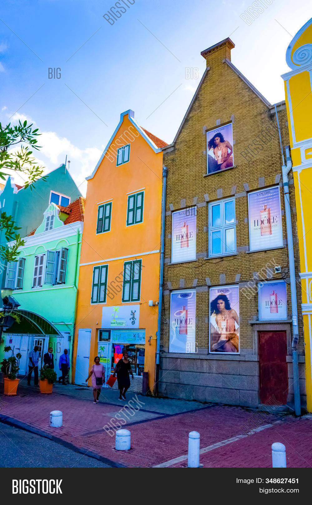 Willemstad, Curacao, Netherlands - December 5, 2019: People At Street With Specific Coloured Buildin