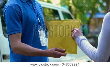 Woman Taking Envelope With Documents From Deliverer Hands, Door-to-door Shipment