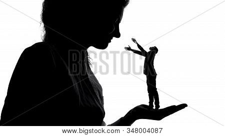 Silhouette Of Lady Holding Tiny Male Admirer In Hand, Women Power, Domination
