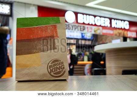 Minsk, Belarus - January 29, 2020: Takeout Packing Paper Bag Burger King On A Table In Background Of
