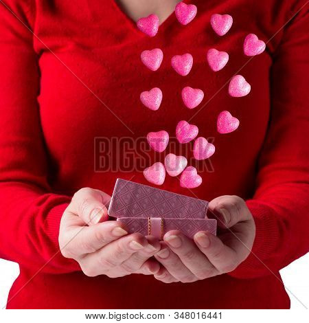 Girl Holds A Gift Box With Pink Hearts. Valentine's Day.