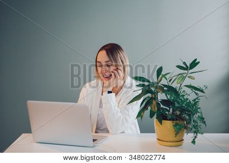 Happy Smiling Laughing Caucasian Business Woman Working On Laptop Computer. Freelancer Working Remot