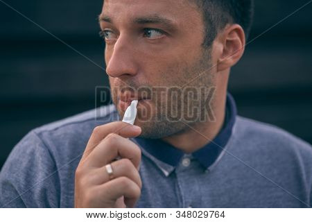 Electronic Cigarettes, Cigarette Technology. Tobacco Iqos System. Close-up Of A Man Smoking An Elect