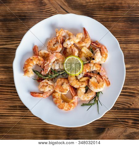 Fried Or Roasted Tiger Big Shrimps In Plate With Spice, Lime, Rosemary And Lemon. Grilled Seafood. H