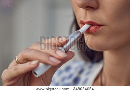 Electronic Cigarette Technology. Tobacco Iqos System. Close-up Of A Girl Smoking An Electric Hybrid