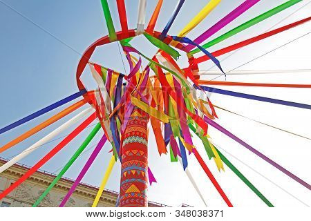 Festive Wooden Pole With Wheel And Colourful Ribbons At Russian National Festival