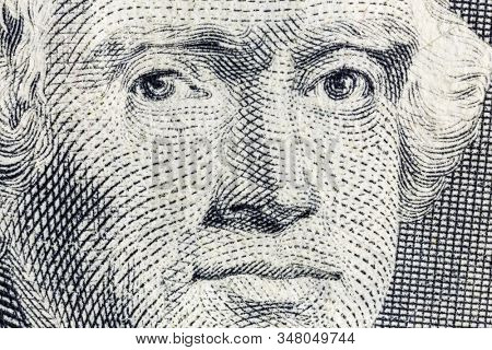 Macro close up photograph of Thomas Jefferson on the US two dollar bill.