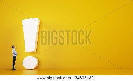 Small Business Man Looks At A Big White Exclamation Mark On A Yellow Background. 3d Rendering