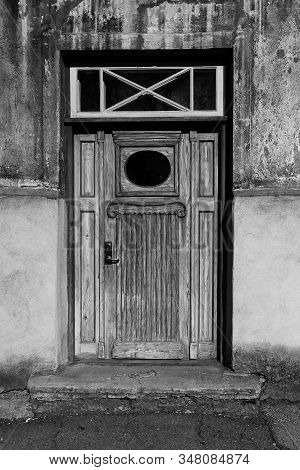 An Old Door With An Oval Shaped Window At Tallinn, Estonia. The Door Has Seen Better Days But Has Ve