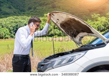 Business People Are Stressed With Broken Cars,opening Hood And Calling For Help On Cell Phone.