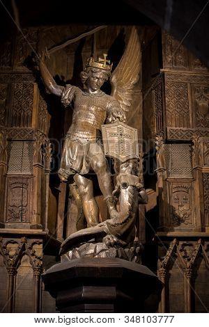 Le Mont-saint-michel, France - September 13, 2018:  Statue Of Saint Michel Killing The Dragoon In Sa