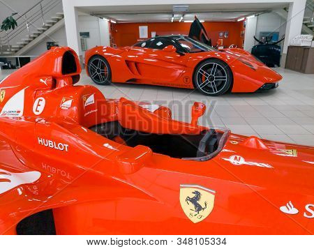 Novosibirsk, Russia - 11.01.2019: Two Red Sports Cars Racing  For Formula 1 Ferrari F399 And Marrusi