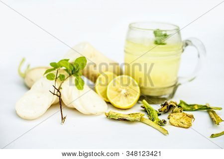Close Up Shot Of Daikon Green Tea In A Glass Mug Isolated On A White Background Along With Freshly S