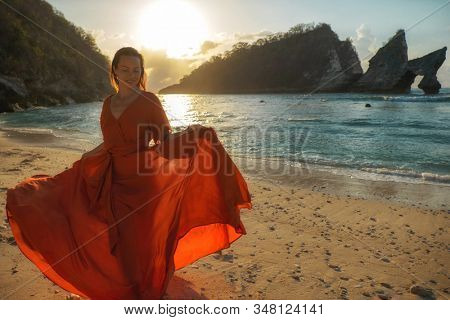 Woman at Atuh beach at Nusa Penida Island, Bali, Indonesia