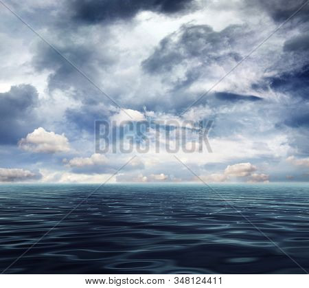 Sea and cloudy sky background