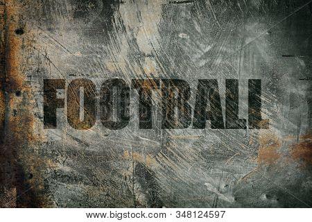 Football written on messy steel background