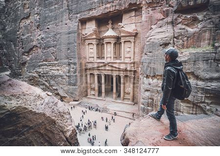 Aerial View Of The Treasury With A Hiker, Solo Traveler, Young Man Tourist On A Cliff After Reaching