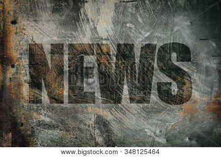 News written on messy steel background