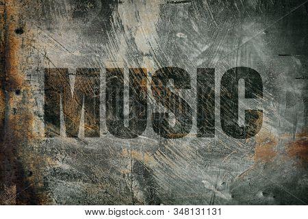 Music written on messy steel background