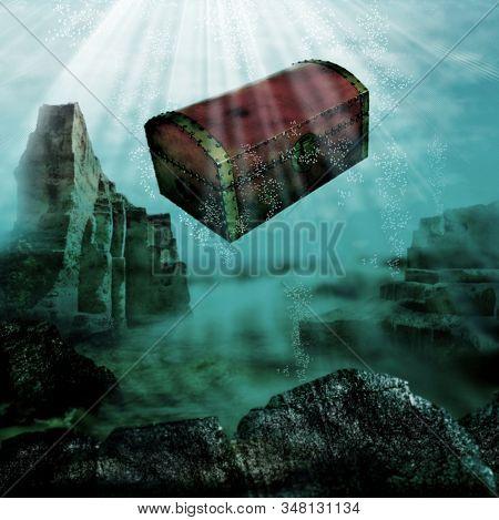 Sinking treasure chest in ocean