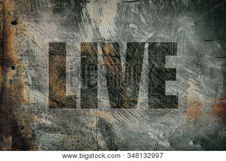 Live written on messy steel background