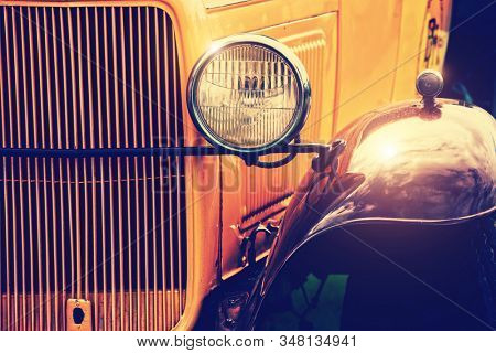 Front section of yellow classic car