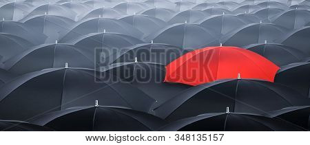 Different And Standing Out Of The Crowd Yellow Umbrella. Concept Of Leader With Many Blacks Umbrella