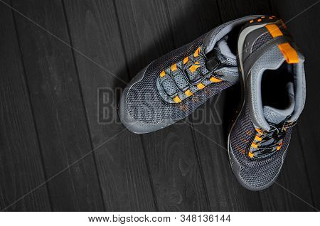 Sports Shoes For Sports And Tourism Stands On A Dark Background.