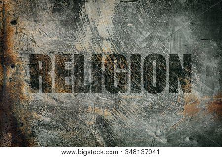 Religion written on messy steel background
