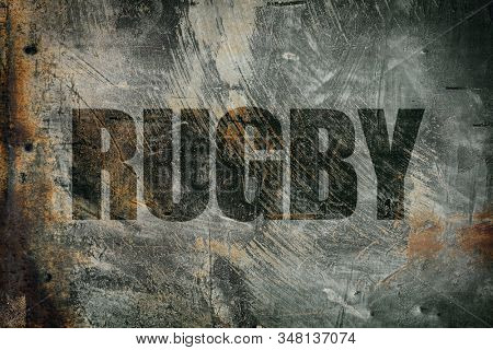 Rugby written on messy steel background