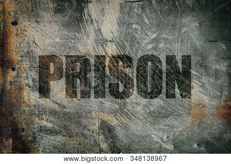 Prison written on messy steel background