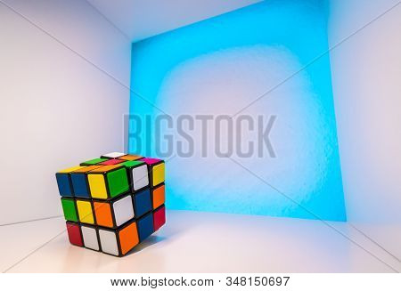 Karlsruhe, Germany On December 8, 2017: Shuffled Rubiks Cube Inside A Cube With Light Blue Backgroun