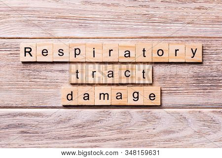 Respiratory Tract Damage Word Written On Wood Block. Respiratory Tract Damage Text On Wooden Table F