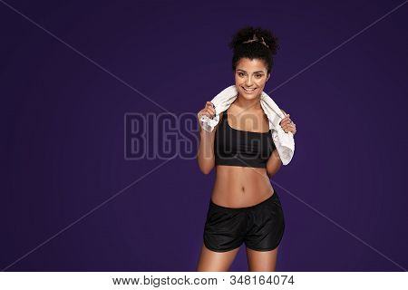 Fit Young Beautiful Afro Woman After Fitness Workout, Smiling, Posing Over Purple Studio Background.